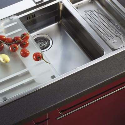 A sink is no longer just a sink with Franke's new Active Kitchen collection. The Mythos sink system (shown) offers an array of accessories including a flexible, tempered satin glass preparation board, a colander, and drain tray. It is available with Franke's rail system for handle mounted components, a pull-out sprayhead faucet, and a matching Mythos vent hood.
