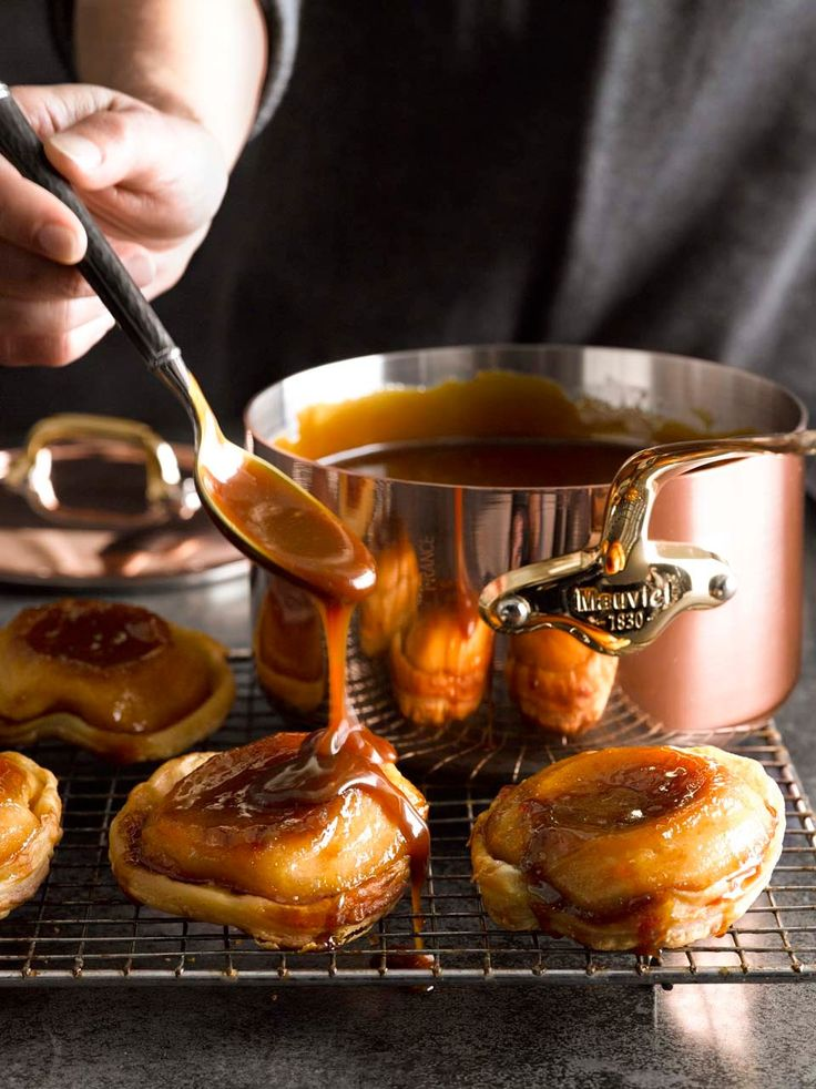 Mini Tartes Tatin with Caramel Sauce | Here, using purchased puff pastry makes it simple to assemble individually sized tarts, which are drizzled with a decadent homemade caramel sauce.
