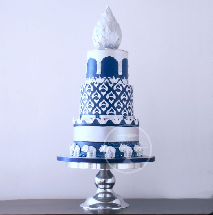 Detailed in India inspired tile patterns, sugar elephants and sugar Lotus bud cake topper.