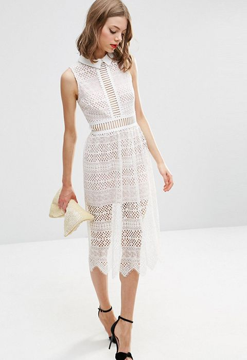Maybe you're a bride, maybe you just love white dresses, whatever your fancy flavour, this equal parts buttoned-up and sheer luxe dress is the one