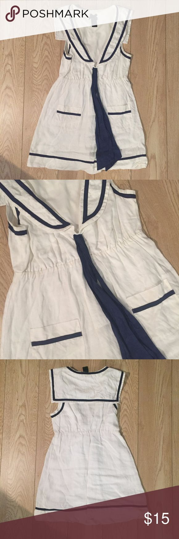 Sailor Style White and Blue Dress OMG, this dress is so great! It's a linen material with great little details like the pockets that make it look like a sailor dress. It's a really cute weekend dress! The blue ties in the front can be tied into a bow. The dress is in good condition, just needs an iron! Forever 21 Dresses