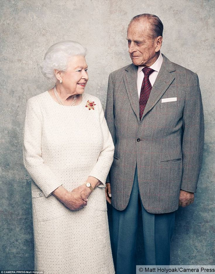 Remarkable milestone: Another photograph sees the Queen, who wears a cream day dress by Angela Kelly, turning affectionately towards her husband   70 YEARS