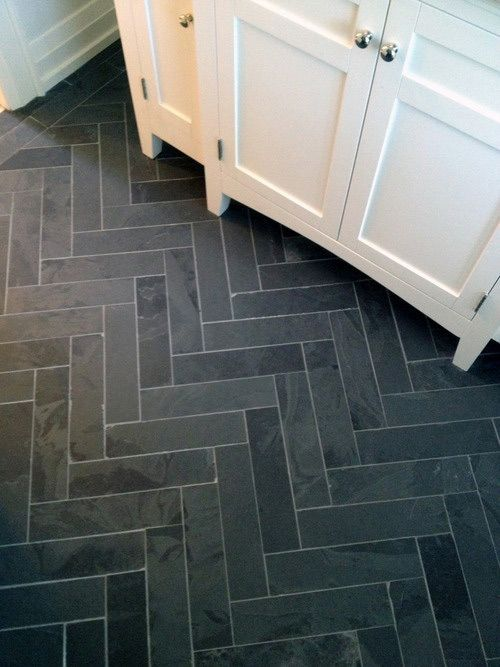 Kitchen/Entry Floor Idea - love this cobblestone look: grey stone tiles layed in a herringbone pattern with subtle grout lines
