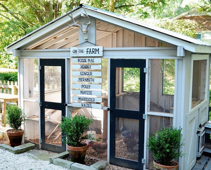 """This family didn't stop at designing their own chicken coop—they added DIY decorations too. Bonus: The cute """"on the farm"""" sign lists the names of all its feathered residents. Get the tutorial at Redeem Your Ground, and learn more about the coop's design."""