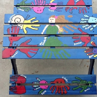 Kids picnic table for school auction with handprint art from each student in my daughter's 1st grade class
