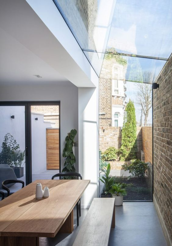 One of the side walls of the house was removed and replaced with a stock brick cavity wall and joined to the rest of the house by a sliver of glazing.