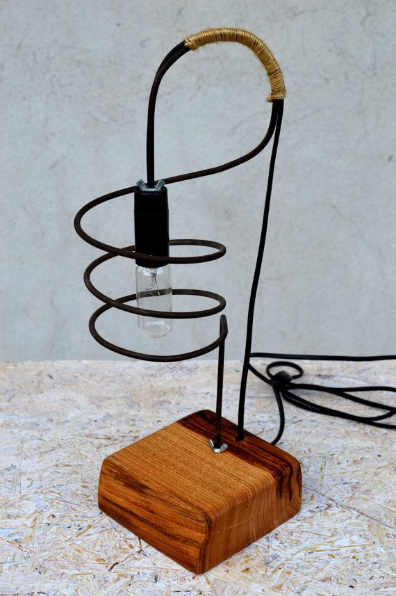 Unique wooden lamp made of solid chestnut wood and stylized steel rod.