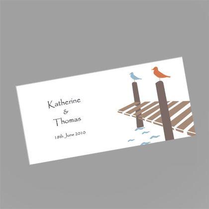 These beautiful wedding invitations feature two birds sitting on a wharf. www.kardella.com