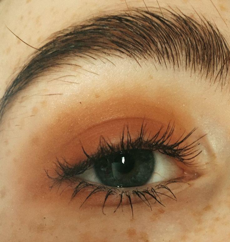 artible bushy brows and dark eyeshadow