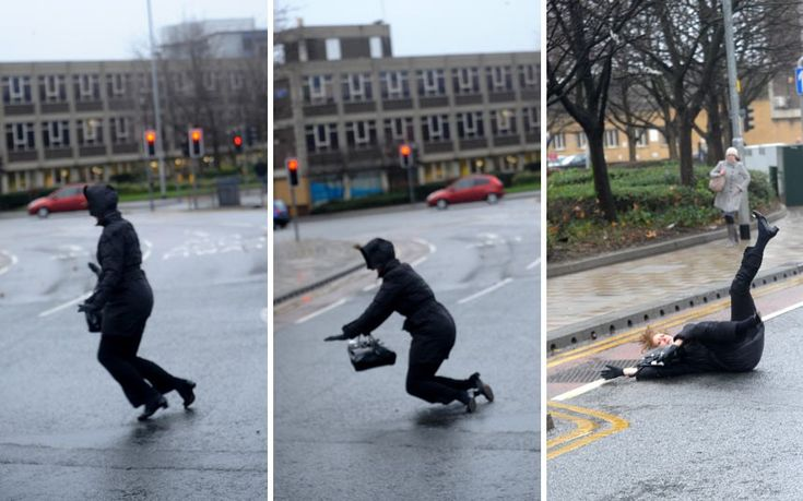 A woman is blown over by strong winds in Leeds. UK weather in pictures: Gale-force winds batter the country. 5th Dec 2013