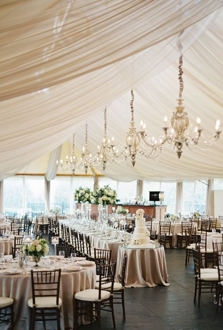 Beautiful Wedding Tent Ideas: Draped Fabric and Hanging Chandeliers | Brides.com