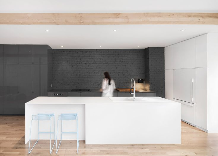 Anne Sophie Goneau exposes brickwork in Montreal apartment