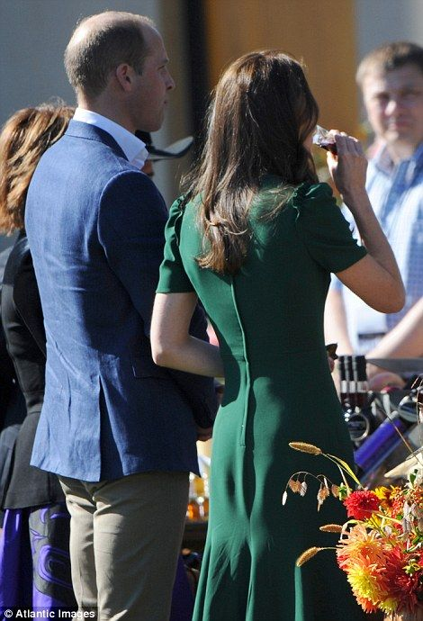 Kate sampled one of the local lacquers. Rear or back view of Catherine's dark green dress. hair worn down.
