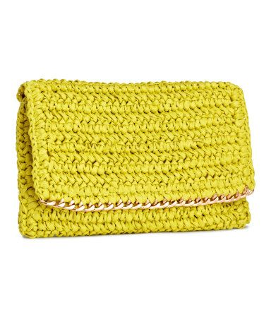 These 14 colorful clutches, purses, and carryalls will brighten any outfit this spring.