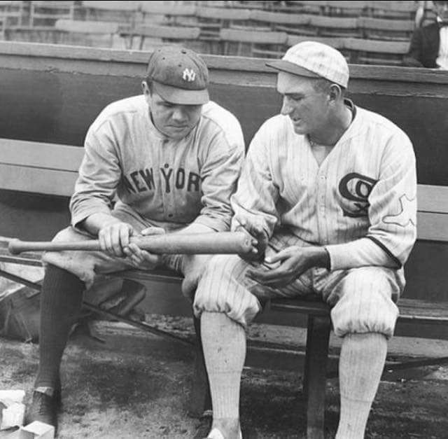 "Babe Ruth and ""Shoeless"" Joe Jackson talking during the 1920 baseball season. This would be Jackson's last season with the majors despite an exceptional performance in the 1919 World Series. He was banned from baseball in 1920 for his participation in the infamous Black Sox Scandal in which he and 7 other members of the Chicago White Sox tried to fix the World Series. He was acquitted of any wrongdoing in 1921. He has yet to be inducted into the Baseball Hall of Fame."