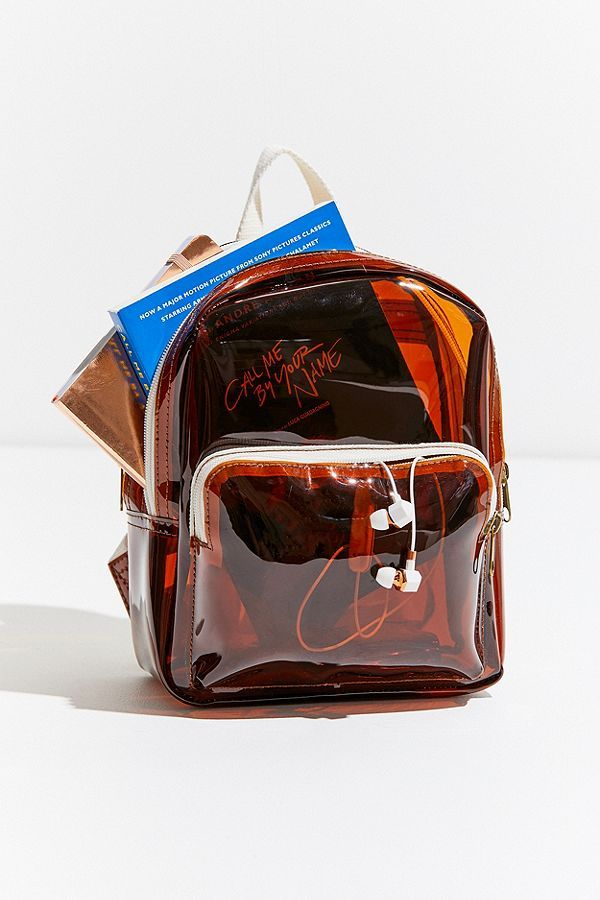 bf9f7b861198 URBAN OUTFITTERS Clear Mini Backpack 020 All the jelly goodness in this  vinyl backpack from Urban Outfitters. Mini silhouette with a zippered main …