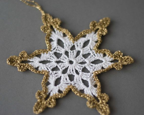 White crochet snowflakes with gold edge.  Handmade Christmas ornaments made with high quality cotton thread and gold lame thread in smokefree and petfree environment.  Each snowflakes measures 4.7x 4.7 approx. (12 cm x 12 cm)   Starched to keep them in shape.  For other crocheted items, please visit my shop: https://www.etsy.com/shop/SevisMagicalStitches?ref=l2-shopheader-name  For hand knitted items, please visit my other shop…