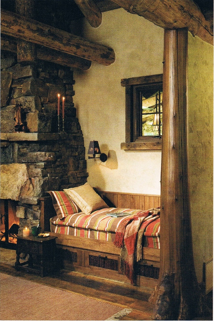 I would be absolutely tickled to have something like this one day! Cute lil reading bench in this rustic home