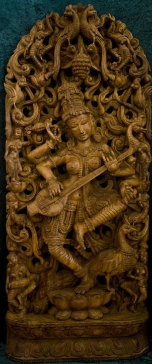 """SARASWATI DANCING IN A GARDEN GROVE - This stunning piece is carved out of a single mango tree trunk. Saraswati, the Godesss of creativity, including poetry, dance, yoga, song, and the study of sacred scriptures. - 54"""" (4.5 feet) tall x 23"""" (2 feet) wide) -"""
