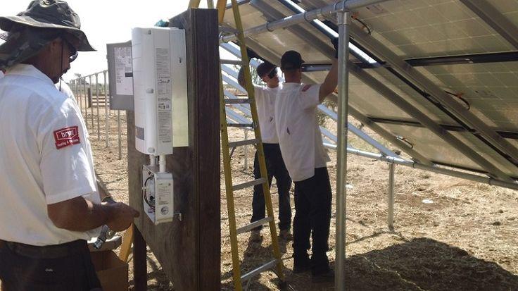 Dan (Left) Working on the Solar panels electrical connections ( Vacaville California HVAC Solano Napa Fairfield Benicia Vallejo Suisun Green Energy )
