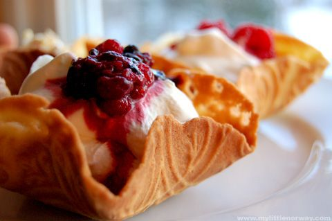 Norwegian krumkake, molded into a cup instead of a cone, and filled with whipped cream and wild berries.
