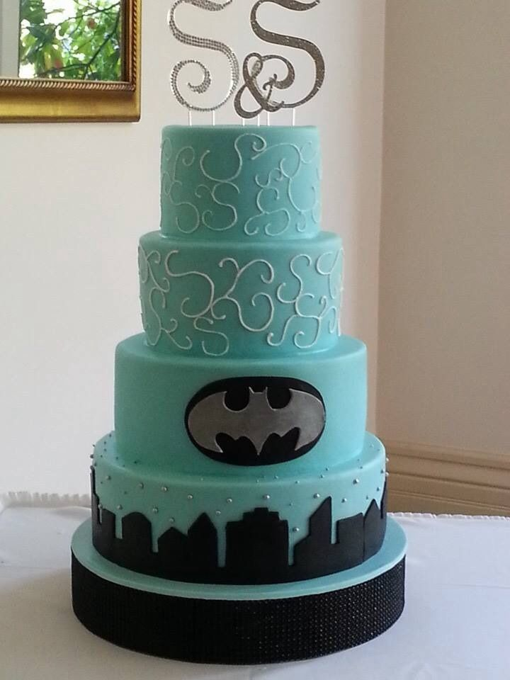 Blue Batman Cake Except A Silver Cake With Dark Blue Accents.