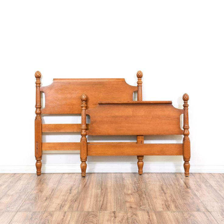 This bed is featured in a solid wood with a glossy maple finish. This traditional headboard and footboard set has pinecone finials, carved turning bedposts, and carved trim. Perfect for a child's bedroom! #americantraditional #beds #headboard&footboard #sandiegovintage #vintagefurniture