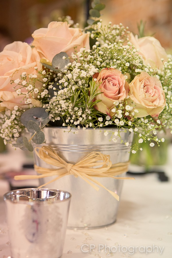 A pretty table centre of pink roses and gypsophilia with rosemary and eucalyptus by Lindsey Kitchin of The White Horse Flower Company www.whfco.co.uk