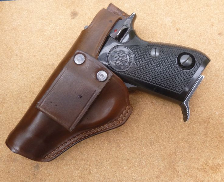 Vertical Small of Back (SOB) carry holster with back thumb break retention strap for Beretta 70 series. Custom made to order from www,makeitjones.co.uk
