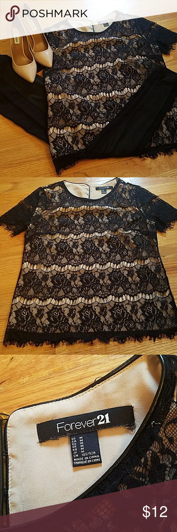 Black and Nude Forever 21 Top Med Medium black and nude top from forever 21. Nude shirt with sheer black lace material overtop. The lace is still intact no damage. The sleeves are sheer with no material underneath.  Send me an offer ! Forever 21 Tops Tees - Short Sleeve