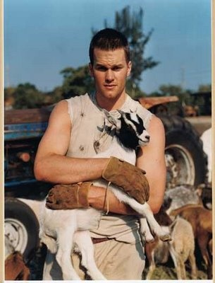 man with goat and jeep
