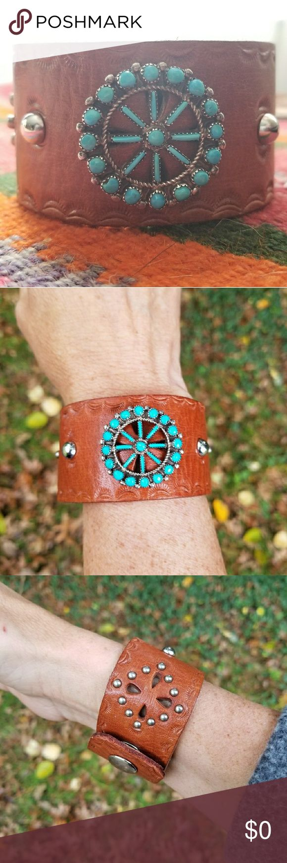 Zuni Needlepoint Snake Eye Turquoise Leather Cuff Vintage Zuni Wheel featuring gorgeous blue Sleeping Beauty Turquoise needle point and snake eye cabachons handcut and set in sterling silver by the Native American tribe famous for their intricate lapidary skills. I attached the wheel to this vintage leather belt featuring tiny studs in a diamond pattern around tear drop cut outs.  I added two domed rivets and hand tooling. Snap closure. Jewelry Bracelets