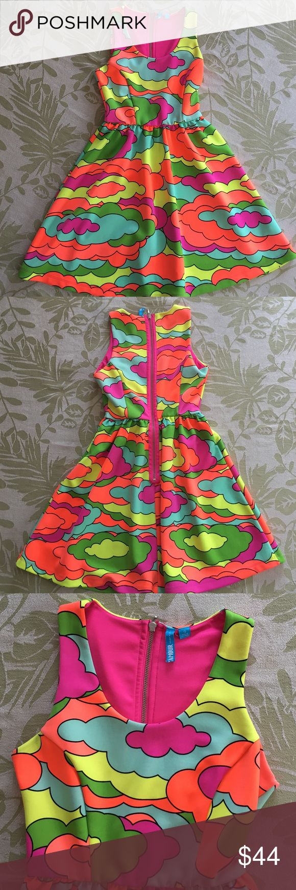 Nanette Lepore Neon color dress Small Beautiful Nanette dress with multi neon colors in clods shapes. Back zipper. Elastic waistband. 93% polyester 7% spandex Nanette Lepore Dresses Mini