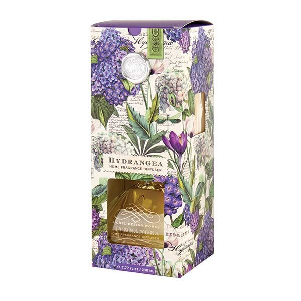 Michel Design Works Home Fragrance Diffuser - Hydrangea — Giftwerks The subtle scent of our fragrance diffuser welcomes guests and enhances the mood of any room. Eight reeds and the elegant glass decanter are packed in a window box for easy viewing.  Scent: Hydrangea Blossom