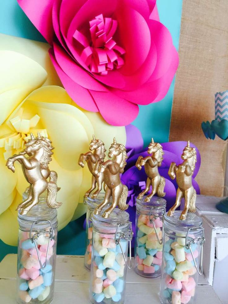 Glittery candy jars at a rainbows and unicorns birthday party! See more party ideas at CatchMyParty.com!