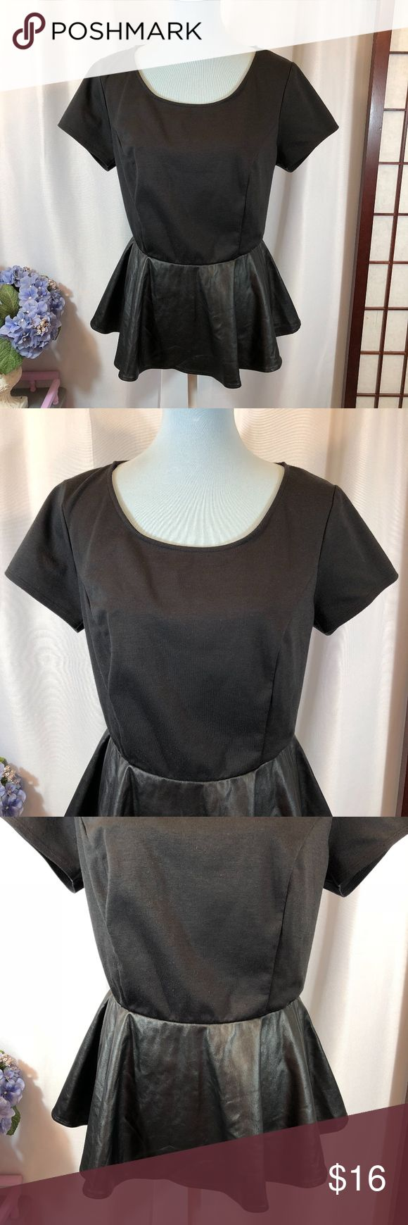 """Forever 21 Black Knit Faux Leather Peplum Top, 1X Brand: Forever 21 Size: 1X Material: 86% Polyester, 9% Rayon, 5% Spandex (Trim - faux leather; Back - 100% Polyester) Condition: Pre-owned in good condition with no rips, stains, or tears  Approx. Measurements Bust: 40"""" Waist: 32"""" Length: 25"""" Forever 21 Tops"""