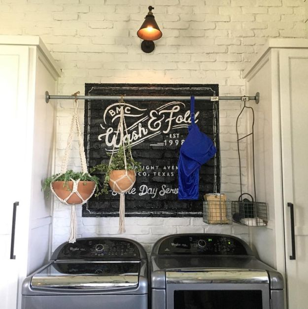 Hang a clothes bar (or a tension rod) above your washer-dryer so you can hang both plants and anything you need to dry. | 15 Decor Tips From Fixer Upper's Jo Gaines You'll Want To Steal Immediately