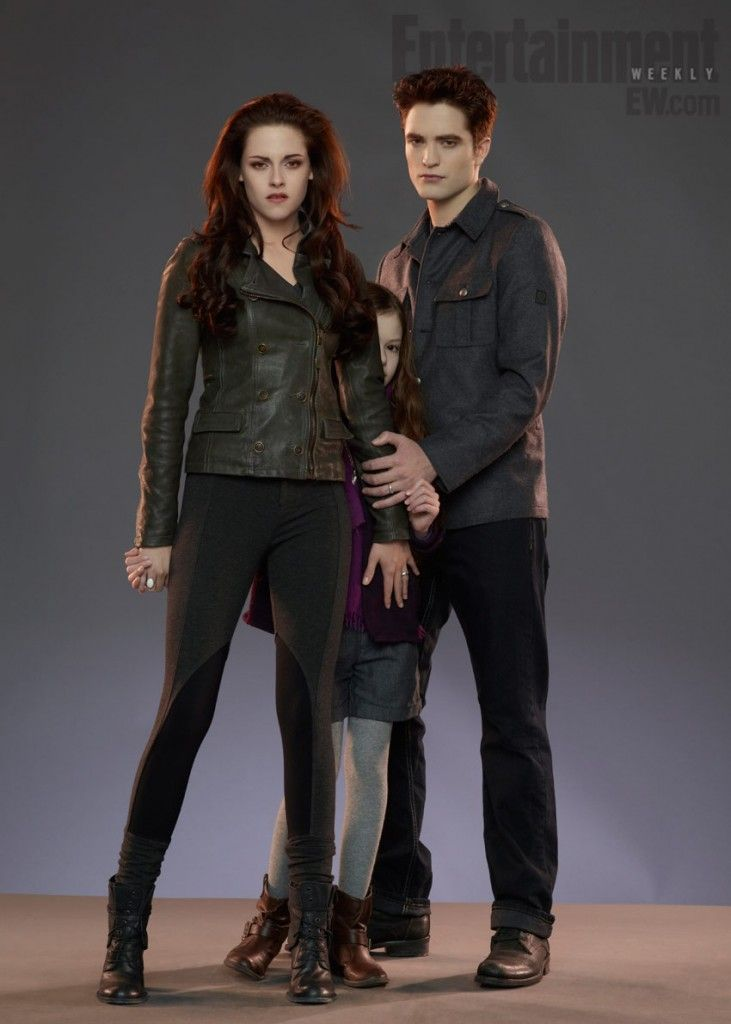 Okay, so while I'm not the biggest fan of Twilight, I've got to admit that this pose is ACE!! Bella standing in front of Renesme, holding her back while holding her other hand on the other side, and Edward trying to hold Bella back, and protect Renesme at the same time...what an awesome photographer to have come up with THAT.