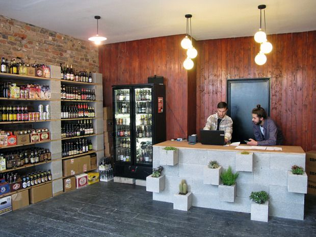 Creative and inexpensive counter made with CMU blocks, rotated to created planting spaces. ClaptonCraft beer