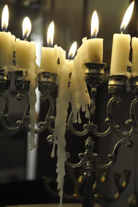 """I have always liked the look of dripping wax candles, elegant and spooky at the same time...I found the best way to get a candle to """"drip"""" is to put a light fan on them while they are melting, not enough to blow the flame out, but enough to push the wax off the top of the candle as it melts. Of course you have to move the fan around or it will all drip on one side."""
