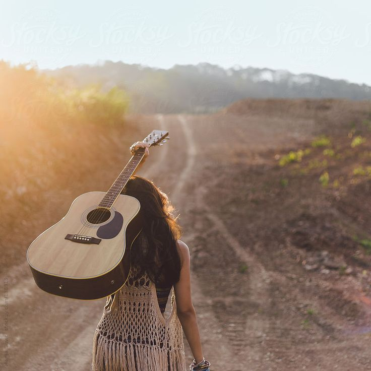 Hippie Woman Carrying her Guitar in the Mountains. by Marija Savic