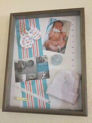 Baby shadow box- so glad I kept the blanket for the background such a cute idea