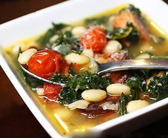CP ITALIAN SAUSAGE, KALE, TOMATO, WHITE BEAN SOUP: Brown 1-2 lb Italian sausage & 4 minced garlic cloves; drain well. Place in 6-qt CP. Add 2 drained cans Bush's white beans & 1 large can Red Gold diced tomatoes w/juice {regular, or Italian style}. Add 5-6 C chicken broth {or 5 C water mixed w/5 bouillon cubes} until completely covered; stir thoroughly. Add 5 C chopped kale greens; fold in completely. Cook on low 6-7 hrs until kale is tender. Yield: 10 servings.