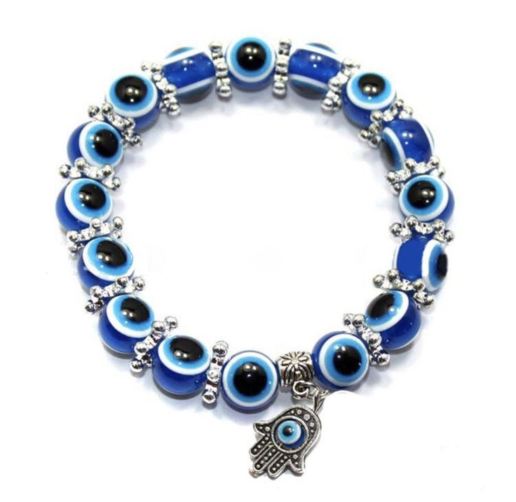 Pulsera artesanal Mal de Ojo de Fatima Beautiful handmade ethnic bead bracelet with Hand of Fatima, made of blue, black and white drop beads, Turkish Turquoise eye design. The Turkish eye is attributed protective forces against evil eye and bad energy and is commonly used in the making of talismans and amulets to protect against the negative influence of people. The bracelet is adjustable with a length to stretch from 14 to 20 cm.