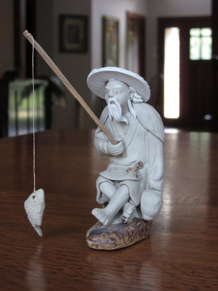 Natural Clay Mudman Fisherman With Rod And Fish