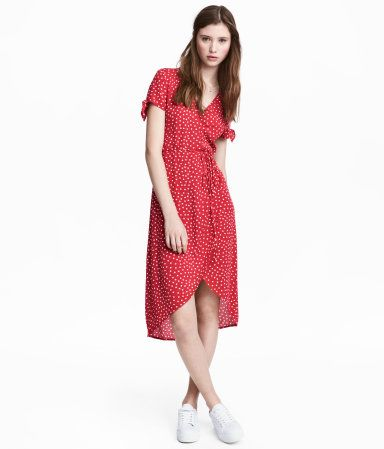 Red/dotted. V-neck dress in woven crêped fabric. Short sleeves with knot detail at cuff. Wrapover front with tie at waist. Asymmetric hem.