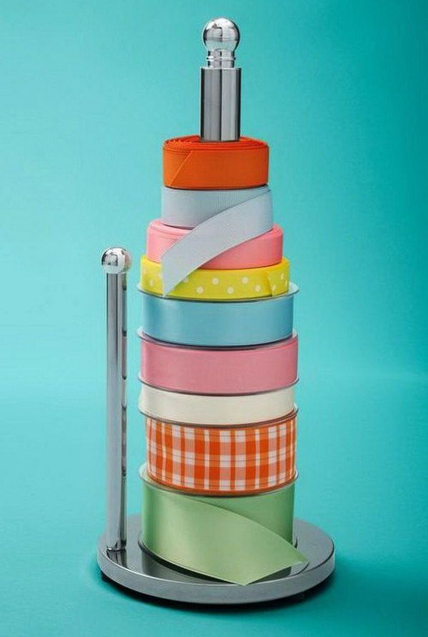 Use a paper towel holder to keep your spools of ribbon organized and easy to get to. http://hative.com/creative-wrapping-paper-storage-ideas/