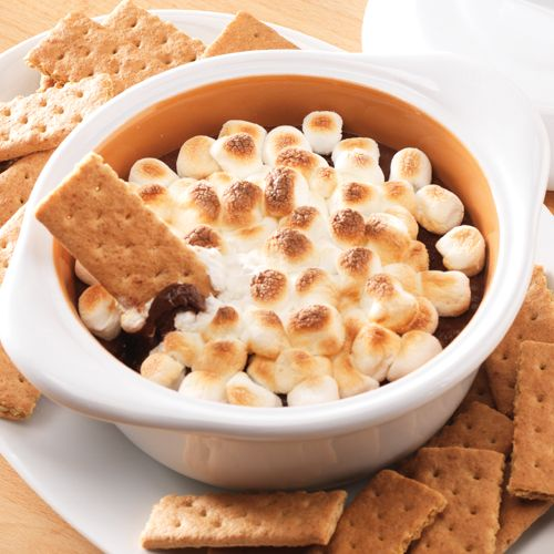 Indoors S'mores - The Pampered Chef®  The Garlic  Brie Baker can do so much s'more! Add 2 cups of chocolate chips, 4 tbs milk and 2 cups of mini marshmallows to a 1.5-qt. Saucepan. Mix continuously over medium heat until melted smooth. Scrape mixture into the Garlic  Brie Baker with a Classic Scraper and top with 1 cup of marshmallows. Bake in a 400°F oven until marshmallows are golden brown (about 6 -10 min.). Serve with graham crackers. Bonfire is optional.