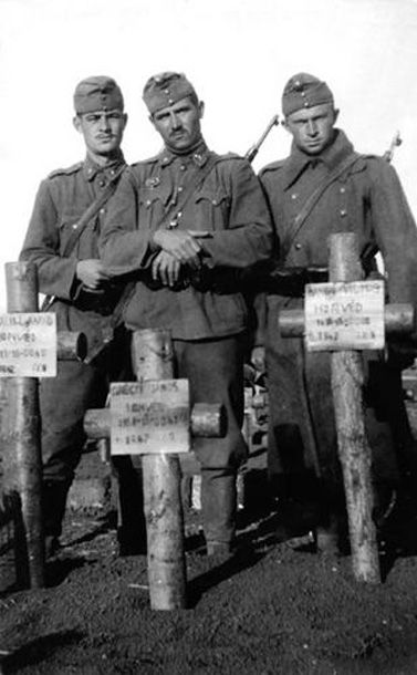 Hungarian soldiers with the graves of their comrades who died fighting for Europe on the Eastern Front. Most likely near the Don river.