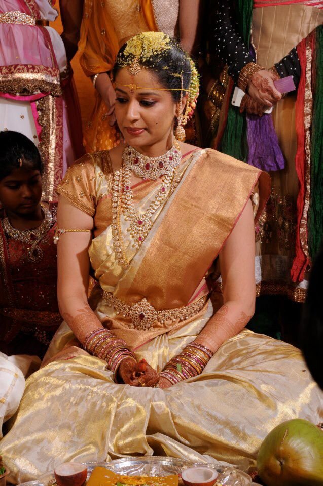 South Indian bride. Gold Indian bridal jewelry.Temple jewelry. Jhumkis.Cream and gold silk kanchipuram sari.Braid with fresh jasmine flowers. Tamil bride. Telugu bride. Kannada bride. Hindu bride. Malayalee bride.Kerala bride.South Indian wedding.